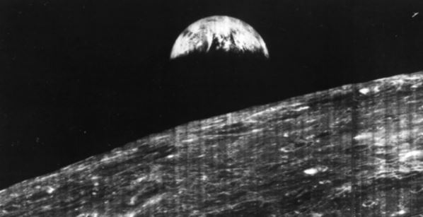 1966 Lunar Orbiter 1: photograph of the Earth, taken from the Moon.