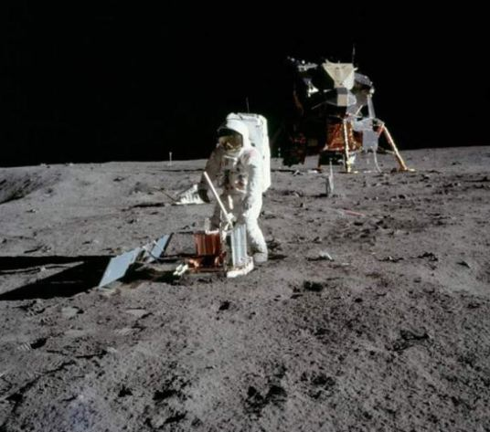 Buzz Aldrin, setting up a seismic detector in 1969. The solar systems's first luno-phone.