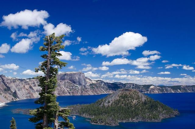 Crater Lake. The island is Wizard Island, a cone in the middle of the volcanic caldera.