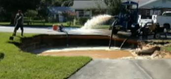 Florida's new sinkhole. Engineers are filling it with water to stabilize it.